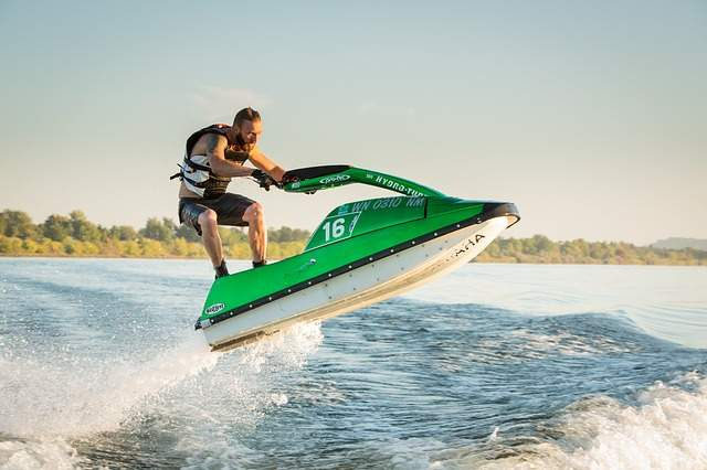 A man soars into the air on a jet drive personal watercraft.