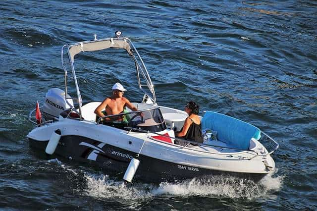 A boat with an outboard motor.
