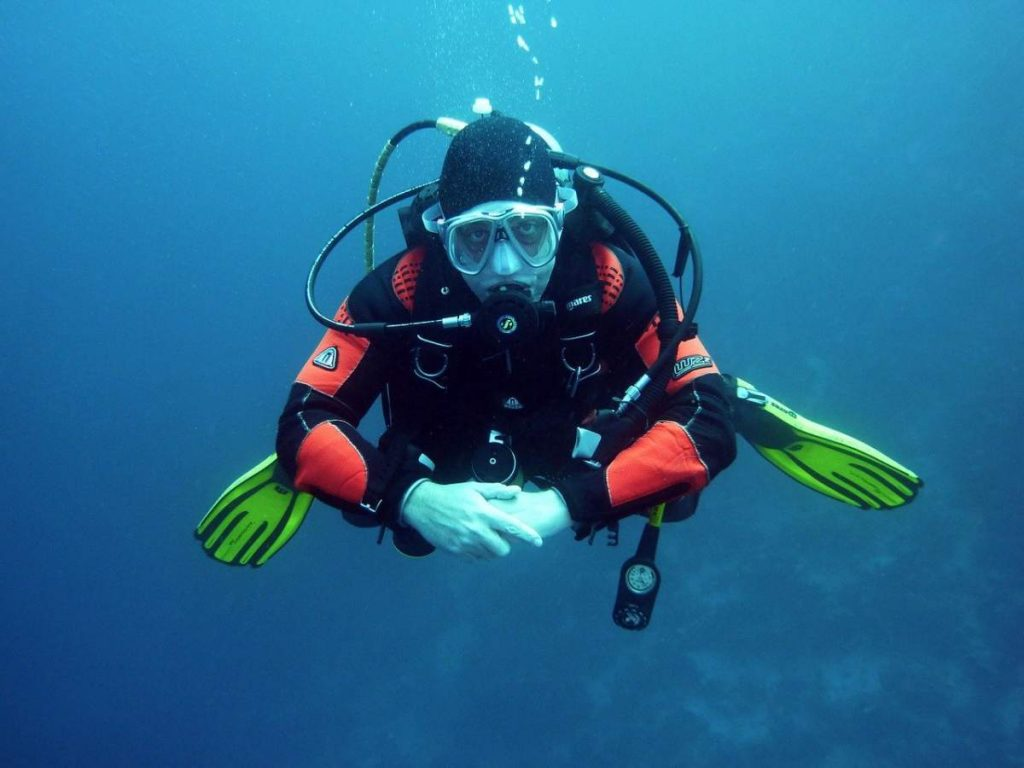 A scuba diver wearing specialty clothing designed for scuba diving.