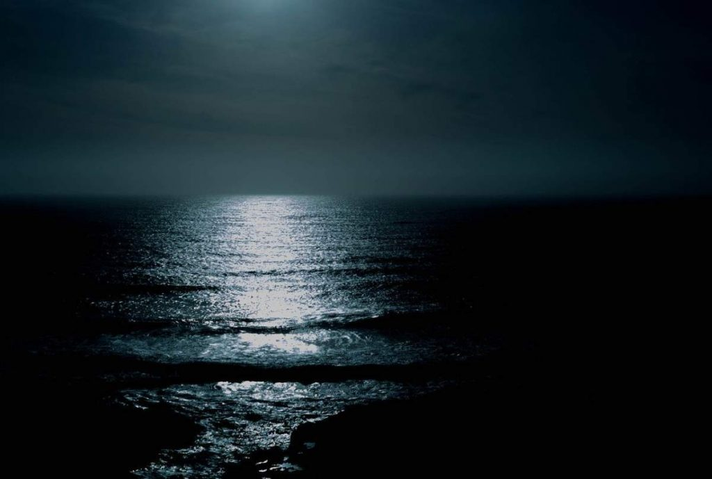 A picture of the dark ocean at night.