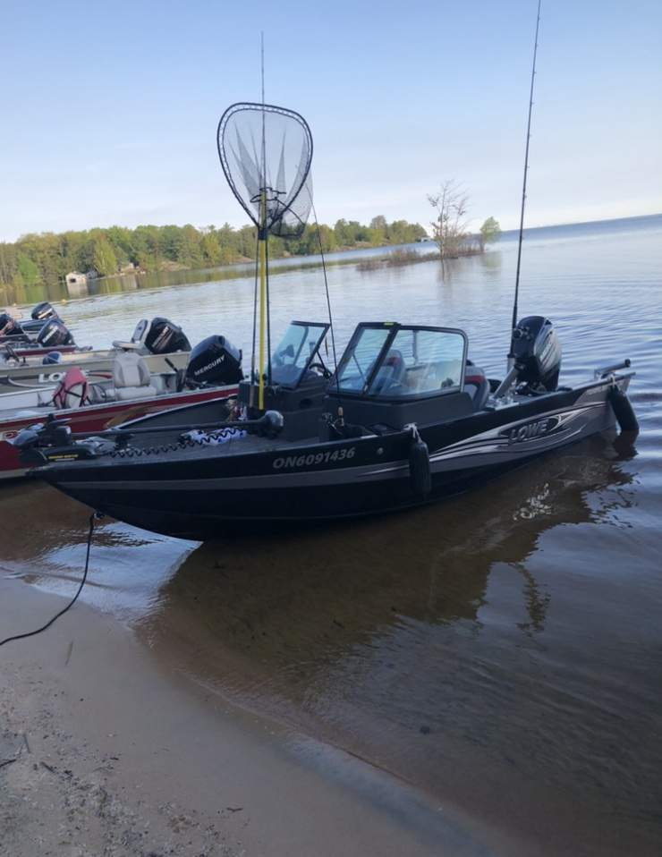 Several fishing boats are pulled up to shore in this file photo.