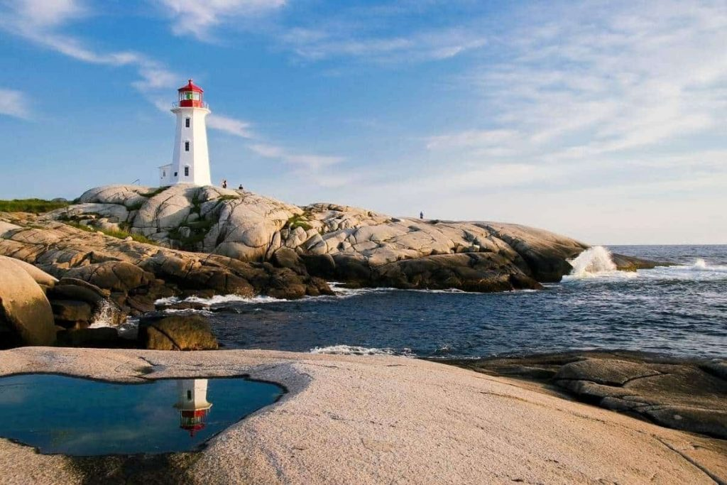 A lighthouse on a rocky shore is shown in this file photo.