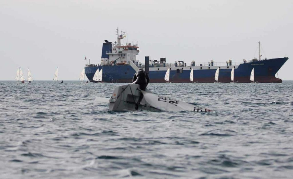 A monohull vessel lays on its side in the water in this file photo.
