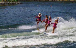 Water skiing behind a boat.