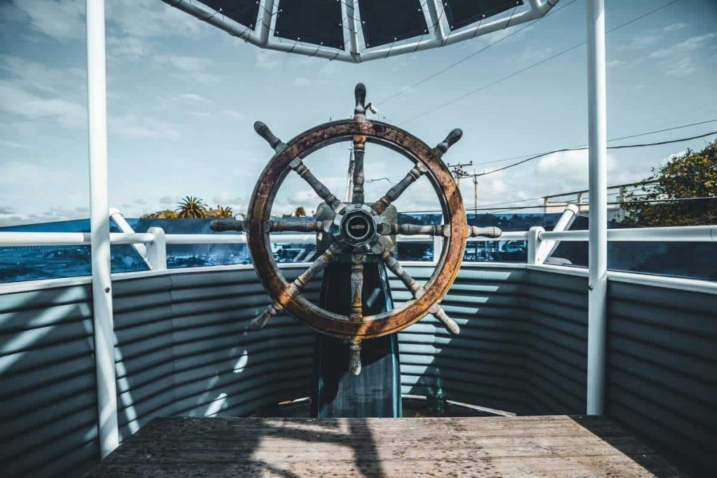 The large wooden steering wheel of a ship is shown in this file photo.
