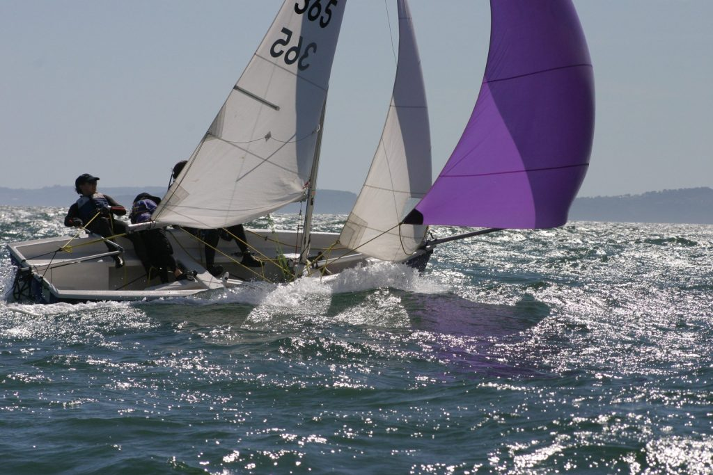 A sailboat is pushed hard by the wind in this photo.