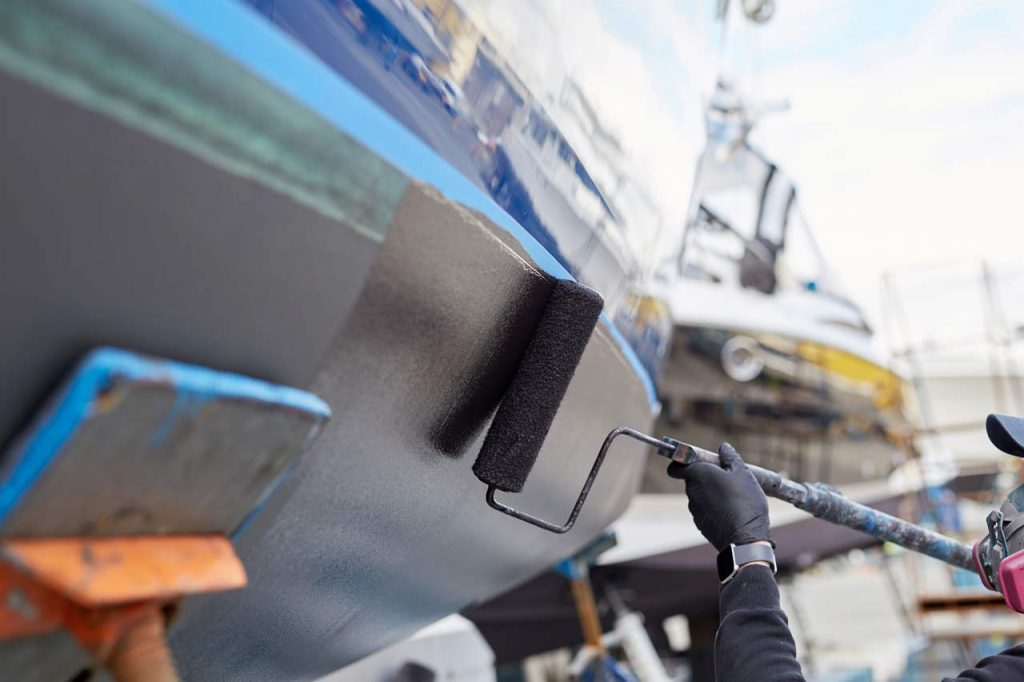 A boat hull is re-painted in this file photo.