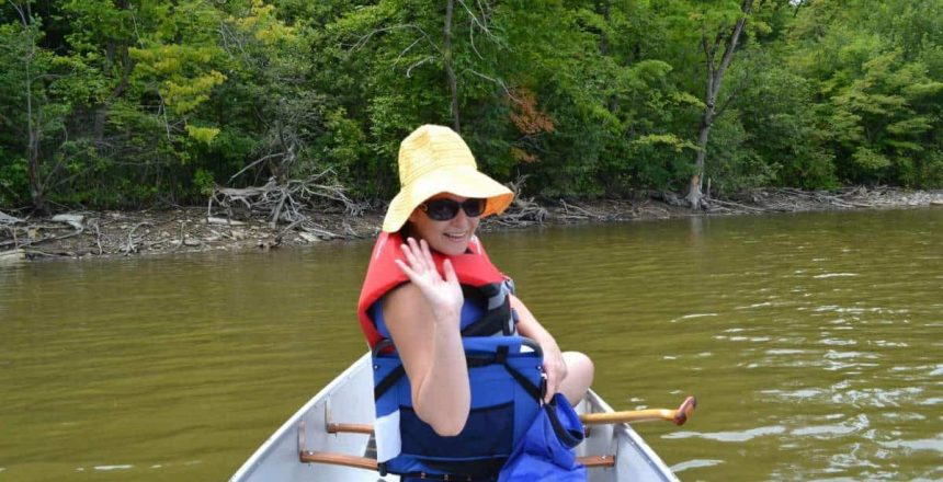 Christine waves hello from the fore section of our 16 foot Kevlar canoe.