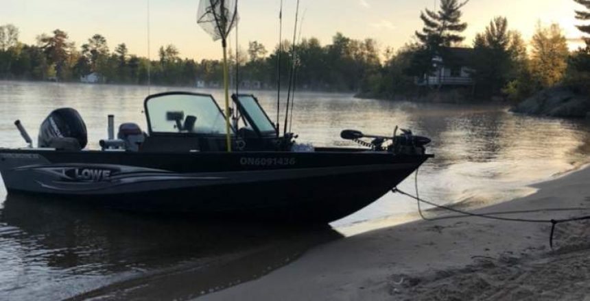 A bass boat driven up onto the beach from shallow water is shown in this file photo